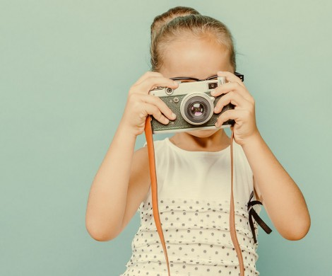 smiling child  holding a  camera